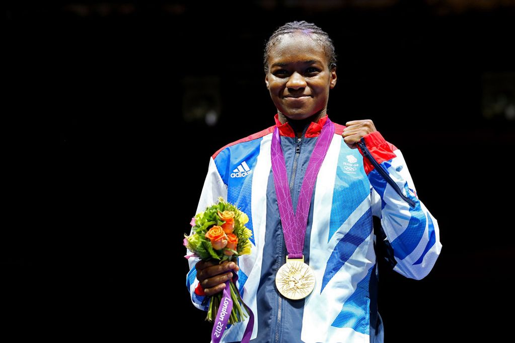 Gold medalist Nicola Adams of Great Britain celebrates on the podium during the medal ceremony after the Women's Fly (51kg) Boxing final bout